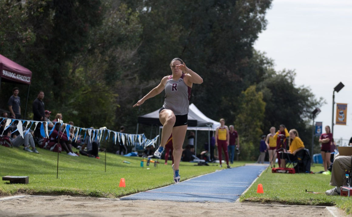 Ali Smith sails in the long jump pit; one of her many events as a heptathlete.