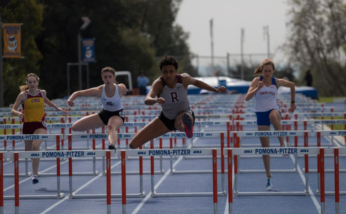 Jessica Fields clears the final hurdle to win her race with a personal record.