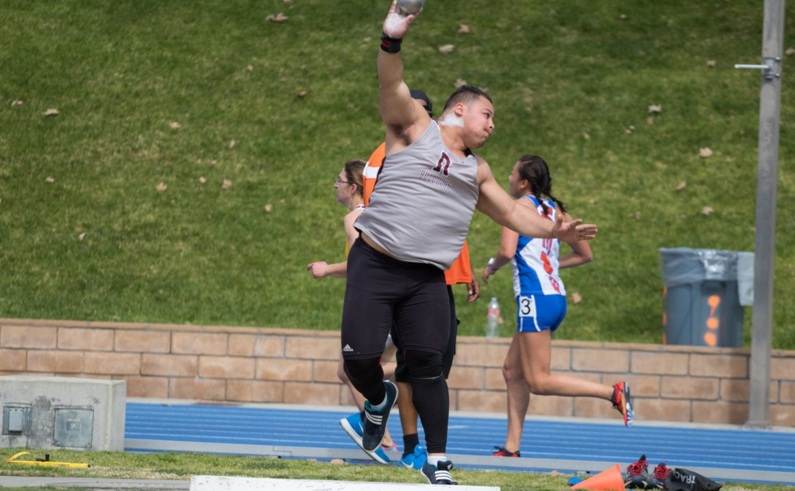 Matthew Hayashi throws the shot put, in just one of the three events he placed in.